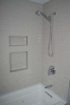 Modern, minimalist guest bathroom shower / bathtub in Seattle home built by Flying Dormer. www.flyingdormer.com