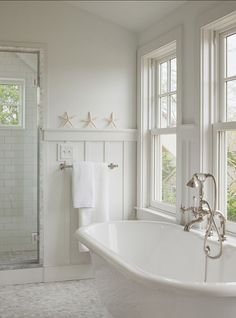 Pretty detail in the wainscotting and tile in this white on white bathroom.