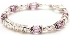 June birthstone Baby Bracelet is a sterling silver and crystal beaded name bracelet designed with round crystals wrapped in Bali silver bead caps.  Sterling silver floating rings accent the style beautifully.