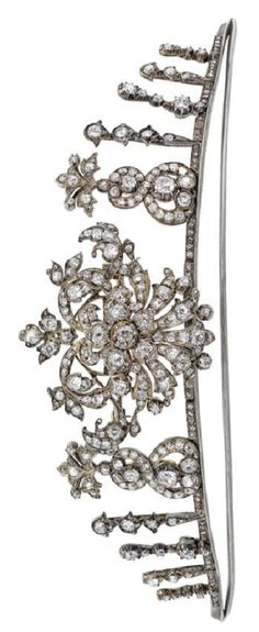 Late 19thC diamond tiara of tapering openwork form, the centrepiece formed as a swagged foliate cartouche, set throughout w/ old round brilliant-cut diamonds, w/ tiers of graduated foliate accents to either side, similarly-set throughout & w/rose-cut diamond highlights, the frame set w/ row of rose-cut diamond accents, above a knife-edge bar support, the centrepiece detachable & w/ brooch fitting, length 19cm, diamonds estimated to weigh approx 6.78cts. Image Bonhams