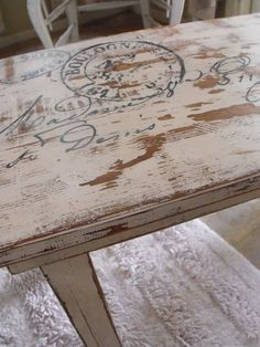 Table Makeover: Painted with a soft color; distressed; graphic applied by coloring back with pencil then coloring design in with Elmer's black paint pen; Sanded; Antiqued using Ralph Lauren Glaze in Smoke; sealed with wax.