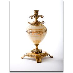 A beautiful and elegant candle holder with colored crystal and hand painted gold embellishments and brass accents.