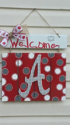 Check out this item in my Etsy shop https://www.etsy.com/listing/384568484/alabama-crimson-tide-wooden-door-hanger