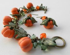 Halloween charm bracelet and earrings  Handmade pumpkin by insou. Polymer clay.