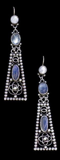 A pair of Arts and Crafts silver and moonstone earrings, British, circa 1905.