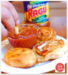 Homemade Pizza Rolls-refrigerated pizza crust, pepperoni, shredded cheese, Parmesan cheese, italian seasoning and dipping sauce. Slices bake for 10-12 min. Easy and tasty!