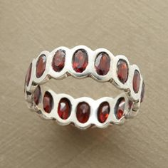 ROWS OF ROSE RING--Sterling windows frame red garnets all around this stunning yet simple sterling silver and garnet ring. Exclusive. Whole sizes 5 to 9.
