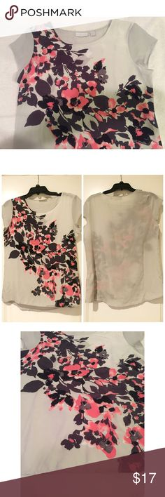 """NWT. Grey short sleeve floral silk top NWT. Light grey short sleeve pink and black floral silk top. About 24.5"""" long from the front and 26"""" long from the back. Floral from the front, plain grey from the back. Short sleeve. Sorry, no trades. Like the item but not the price, feel free to make me a reasonable offer using the offer button below. New York & Company Tops Blouses"""