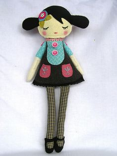 Love the use of pattern material for the leggings.  Genius.  Found in nooshka doll's flickr stream.