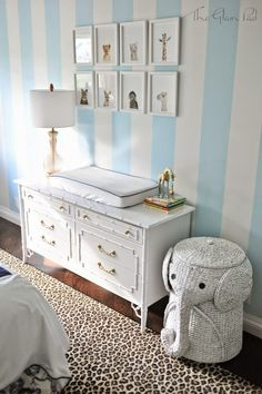 Palm Beach Regency Nursery Reveal - The Glam Pad Paint: Striped walls: Open Air and Extra White by Sherwin Williams Dresser and nightstand: Valspar Paint + Primer Premium Finish in White Gloss, Rust-Oleum Gold Metallic for handles