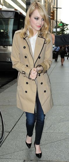 Emma Stone wearing a Burberry trench coat in New York