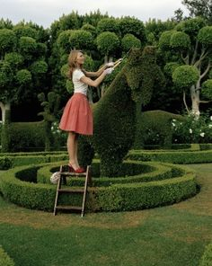 You know.. sometimes you just gotta trim those goat shaped hedges in your adorable poodle skirt and heels ;)...