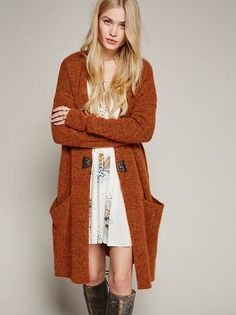 Cozy knit cardigan featuring a long, effortless shape and a soft and stretchy fabrication. Slouchy side pockets. Front hook closure detail.