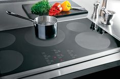 It's the culinary equivalent of a smartphone. Once she's tapped on a high-powered induction unit and watched it fire up so fast that there's no time to chop an onion, she'll never want to go back to slow-poke electric or unruly gas. Pictured here: GE PHP960 36-inch induction cooktop | thisoldhouse.com