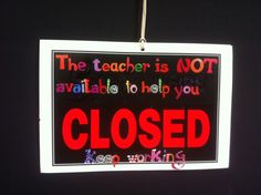 use an open/closed business sign as a visual signal for students about when you are available to help