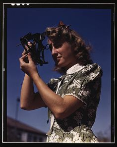 Learning how to determine latitude by using a sextant is Senta  Osoling, student at Polytechnic High School, Los Angeles, Calif.  Navigation classes are part of the school's program for training its  students for specific contributions to the war effort, Sept. 1942