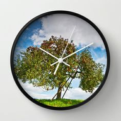 """Appletree Wall Clock by Pirmin Nohr - $30.00 beautiful appletree on a Meadow.  He has a """"neighbour"""" just some steps away, here:  http://society6.com/PirminNohr/Another-appletree  Flora, nature, rural, sky, clouds, autumn"""