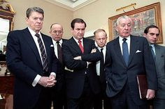 President Reagan and his staff, like most Americans, were glued to their television sets in the wake of the Challenger explosion, waiting for news and watching replays of the disaster. (left to right) Ronald Reagan, James Poindexter, Pat Buchanan, Alfred Kingon, Don Regan, Edward Djerejian