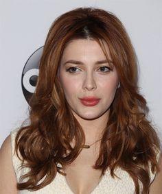 Elena Satine Long Wavy Hairstyle.