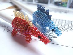 Beaded Stegosaurus Pen-topper by JacksonsBeadwork on Etsy
