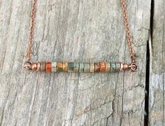 "Simple bar necklace with small red creek Jasper stones and antiqued copper chain. Approx 18"" as shown but length may adjusted upon request."