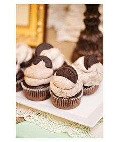 Top cupcakes with cookies made for dunking. (Milk is absolutely required.) | Photo by: Cheryl Joy Photography on Style Unveiled via Lover.ly (Top Cupcake Desserts)