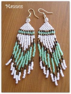 Mintgreen bronze and white fringes.