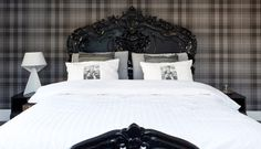 cool, ornate headboard and I love the plaid wallpaper. #bedrooms #interiors #design