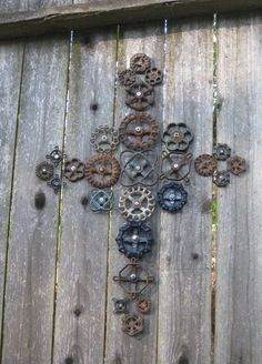 Garden art from faucet knobs~Cross these are nailed. They might? be welded to hang anywhere maybe??