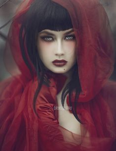 lovely view of a red ridding hood couture / dark goth beauty photo.