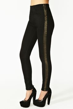 Love the Tuxedo look for Fall! Pair with a blazer and sky high platforms to be the best badass you can be!     Metal Stripe Skinny Jeans by Washborn -- Nasty Gal