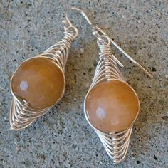 Carnelian Earrings with Cool Silver Wire Weave - Peach Earrings - Geometric Jewelry  I have these in amethyst.  So pretty!  Love this shop.