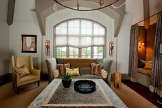 Amazing living room - gorgeous window with arch, and secret reading nook! AH!  (Circa Interiors & Antiques - Heather Smith, Designer www.circaonline.net Photo by Steve Cooke Photography)