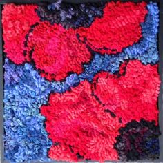 Poppy rug hooking by Deanne Fitzpatrick. Red poppies with bright blue background. Floral print.
