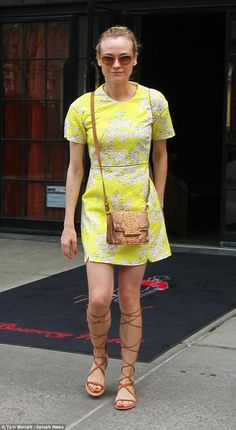 Summer style: Diane Kruger was looking lovely in a bright structured dress as she left her...
