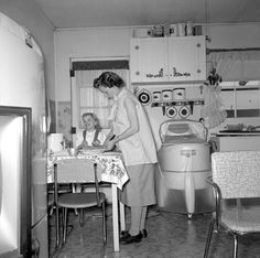 1955 Kitchen - check out the plastic cover on the wringer-washer.