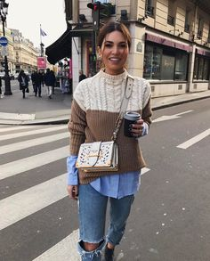 Negin Mirsalehi street style: white and cognace cable knitwear sweater, blue shirt, denim trousers