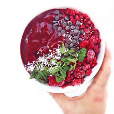 Mint Acai Bowl made with acai powder, frozen cherries and blackberries, fresh mint leaves and filtered water.