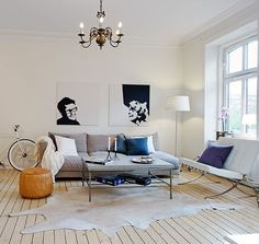 I'm no Interior Designer but I would most def do this on a dark wood floor and let it pop more!!!  White Cowhide Leather Rug