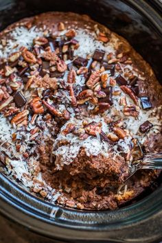 This decadent Slow Cooker German Chocolate Spoon Cake is a delicious spin on German chocolate cake, this is served this warm with ice cream!