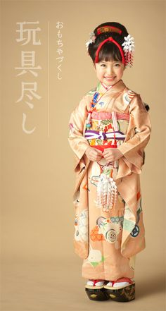 Kimono little girl. Pattern of this kimono is a traditional toy of Japan.