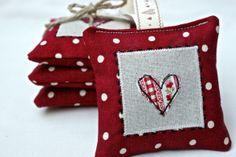 Free-hand machine appliquéd lavender bags via Emily Carlill