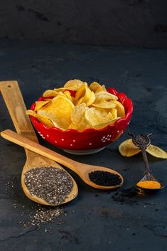 Side view of potato chips in bowl and wooden spoons with black seeds on black #paid, , #AD, #PAID, #potato, #view, #bowl, #chips Photography Backdrop Stand, Snack Recipes, Snacks, Wooden Spoons, Potato Chips, Side View, Camembert Cheese, Seeds, Potatoes