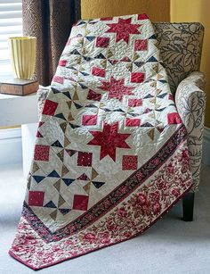 Stars and Pinwheels combine to make this full-size beauty. Holiday Stars, by Gerri Robinson, is perfect for Christmas, but would look lovely in your house all year long. Use our quilting video tutorial, Sew Easy: 8-at-a-Time Triangle-Squares, to get the most out of this project.