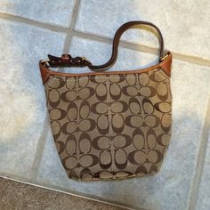 Coach handbag Only used a handful of times, no sign of use other than a tiny mark on the bottom!(last picture). Other than that, perfect condition! Coach Bags