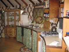 the kitchen in a charming country yurt