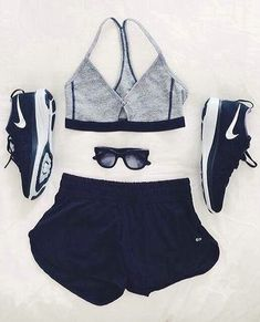 All NIke - Grey sports bra, black shorts, black shoes and sunglasses