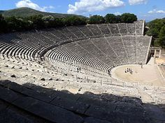 Theater at Epidaurus - Greece.   The theater, dating to the 4th century B.C. and arranged in 55 semi-circular rows, remains the great masterwork of Polykleitos the Younger. Audiences of up to 14,000 were able to hear actors and musicians--unamplified--from the back row of the architectural masterpiece.
