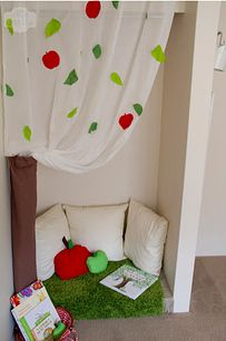 "Way cute makeshift reading nook with ""under the apple tree"" theme"