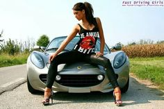 ARYFASHION -LOTUS ELISE SILVER SPORTS CAR SHE'S SITTING ON THE HOOD OF HER CAR